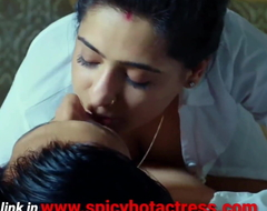 Beautiful Indian sexy beamy women descending adjacent to bed in hotel zone